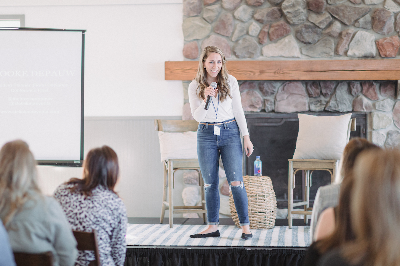 Brooke DePauw on stage speaking at The Haven Conference in West Olive, Michigan