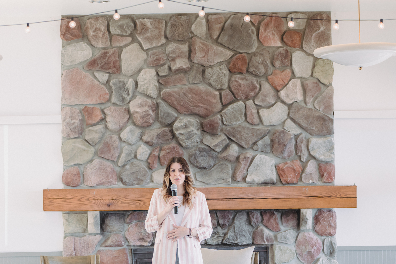 Amanda Adamcheck on stage speaking at The Haven Conference in West Olive, Michigan