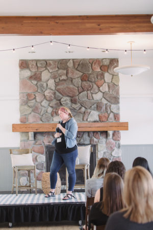 Kalin Sheick on stage speaking at The Haven Conference in West Olive, Michigan