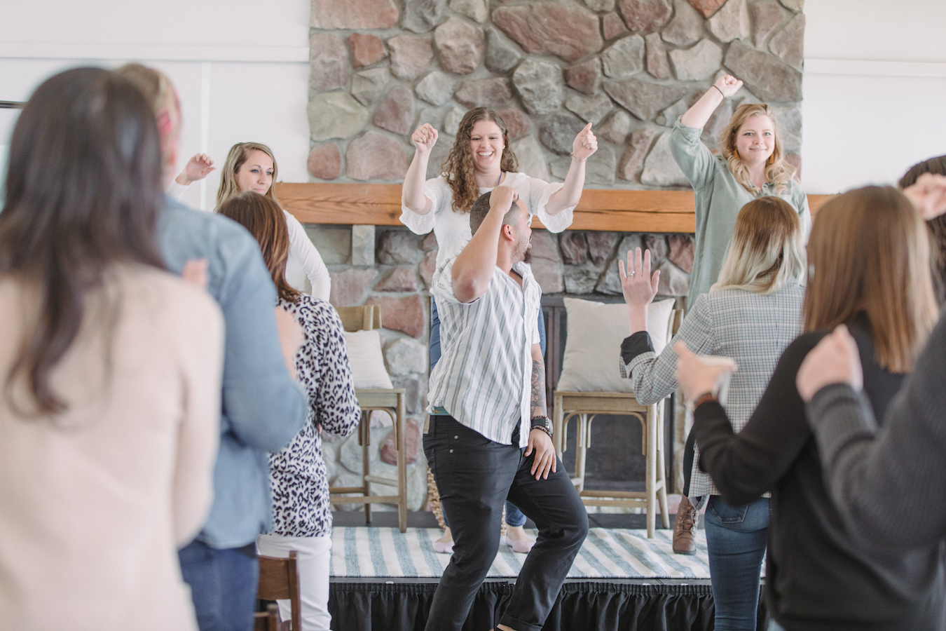 Attendees smiling and dancing at The Haven Conference