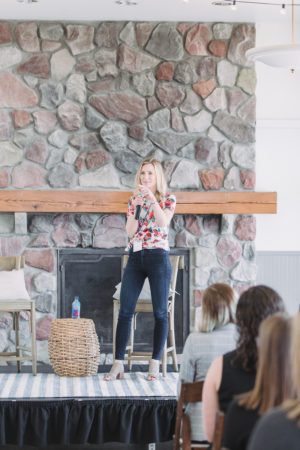 Brittney Suttle on stage speaking at The Haven Conference in West Olive, Michigan