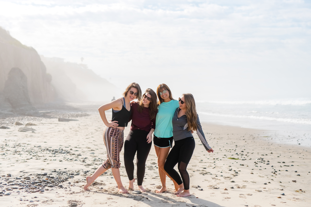 Girls smiling during a San Diego business retreat