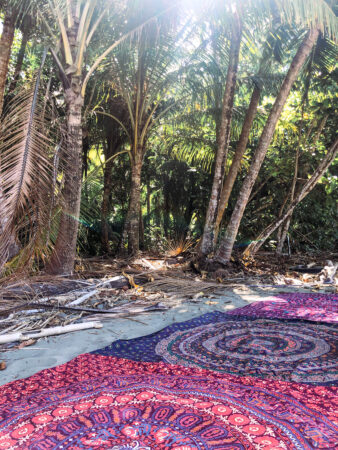 tapestries set for meditation on a beach in Uvita, Costa Rica